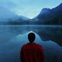 Man Seeking Depression Treatment Looks Across A Misty Lake