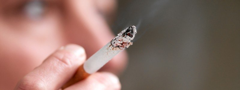 person with cigarette seeks hypnotherapy for smoking